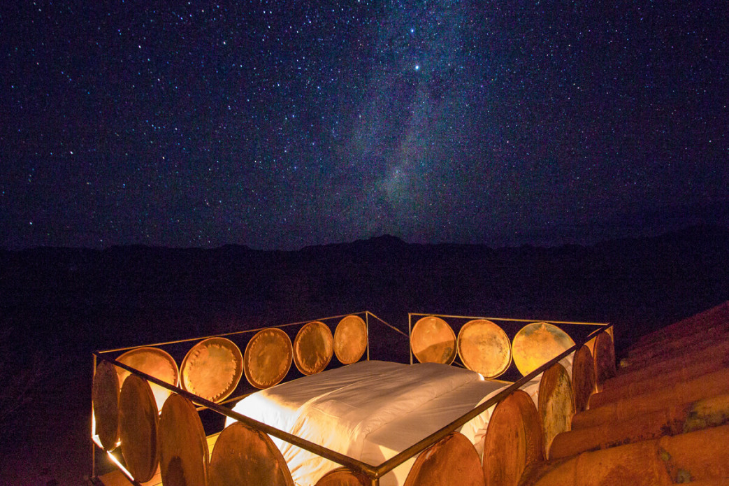 "Sleep in star beds under a spectacular blanket of stars at <strong class=""text-green"">Camp Sossus</strong>"